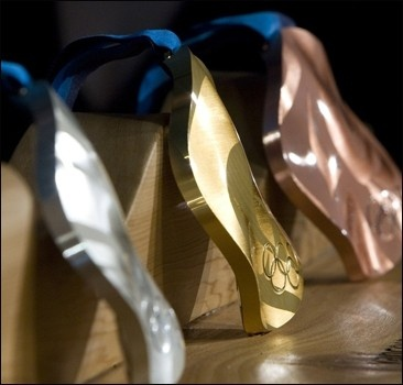 """Ломанное"" золото Ванкувера тянет на 500 у.е."